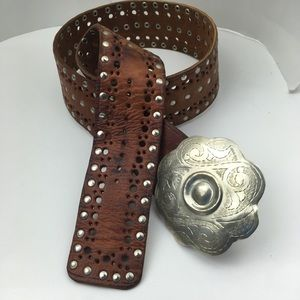 Brown leather Morocco belt .